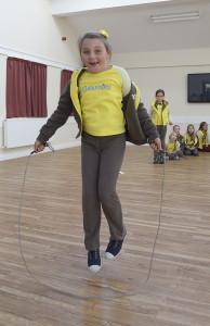 Bempton Village Hall 1st Bempton Brownies doing a sponsored skip to raise funds for the Nepal disaster. NBFP PA1524-4c