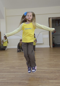 Bempton Village Hall 1st Bempton Brownies doing a sponsored skip to raise funds for the Nepal disaster. NBFP PA1524-4i